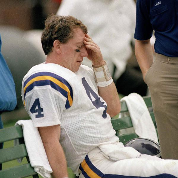 Minnesota Vikings' quarterback Archie Manning (4) sits dejectedly on the bench after being injured during game with the San Francisco 49ers at Candlestick Park, Dec. 8, 1984. The Vikings lost 51-7. (AP Photo/Paul Sakuma)