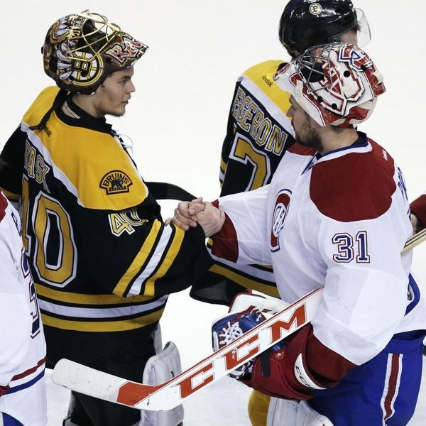 Montreal Canadiens goalie Carey Price (31) is congratulated by Boston Bruins goalie Tuukka Rask (40) after the Canadiens' 3-1 win in Game 7 of a second-round NHL hockey Stanley Cup playoff series in Boston, Wednesday, May 14, 2014. The Canadiens advanced to the Eastern Conference finals against the New York Rangers. (AP Photo)