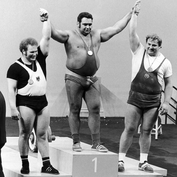 The super heavy weightlifters of the summer Olympic final in Munich on Sept. 6, 1972, during the winners ceremony in the Munich fair hall. From left; second place German Rudolf Mang, gold medal winner Vasily Alekseyev of Soviet Union, and third placed East German Gerd Bonk. (AP Photo)