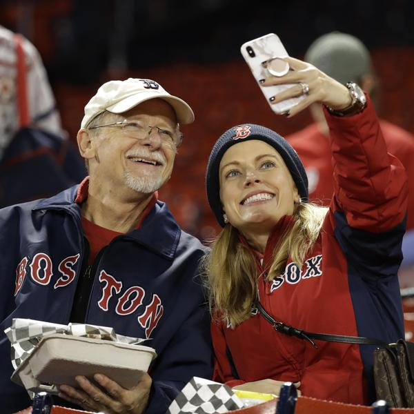 Boston fans take a selfie before Game 1 of the 2018 World Series between the Boston Red Sox and Los Angeles Dodgers at Fenway Park.
