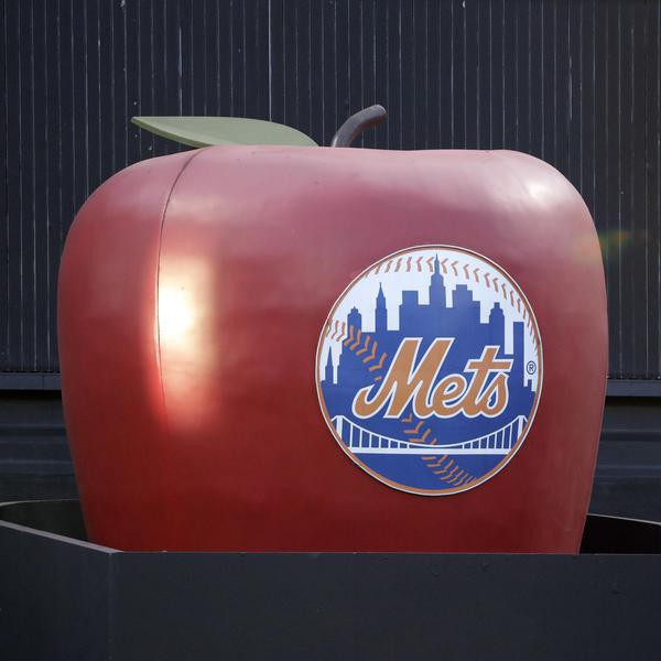 The apple in center field at CitiField, home of the New York Mets, is up before the start of a baseball game between the New York Mets and the Chicago Cubs, Tuesday, Aug. 27, 2019, in New York. The apple pops up every time a Metss' player hits a home run. (AP Photo/Kathy Willens)