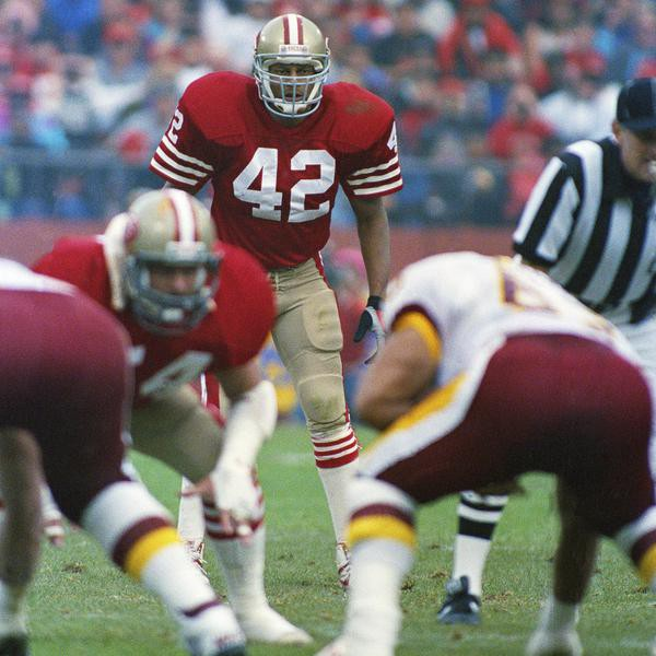 FILE - In this Jan. 12, 1990 file photo, San Francisco 49ers safety Ronnie Lott waits for the snap during the 49ers NFC divisional playoff game against the Washington Redskins in San Francisco. Lott was selected to the Super Bowl 50 Golden Team, Thursday, Jan. 28, 2016.  (AP Photo/Jack Smith, File)