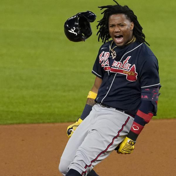 Atlanta Braves' Ronald Acuna Jr. celebrates after a double against the Los Angeles Dodgers during the ninth inning in Game 1 of a baseball National League Championship Series Monday, Oct. 12, 2020, in Arlington, Texas. (AP Photo/Tony Gutierrez)
